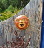These eye-catching sun decorations come with blue or gold faces.