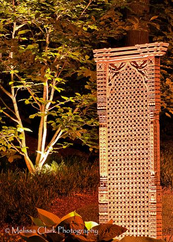 Magnolia 'Leonard Messel,' garden sculpture, garden lighting