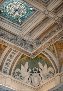Detail of the ceiling and an ornately carved corner.