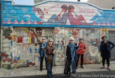 Tour members appreciating a mural on the opposite side of the alley.