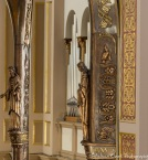 The baldacchino's suports are intricately designed with figures of saints and symbols.