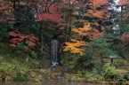 A view near a tea house, with fall foliage in its glory.